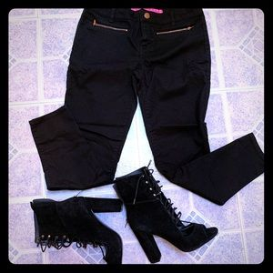 Black pants with rose gold zippers